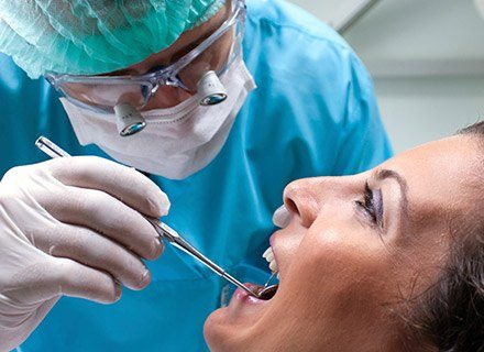 Dentist treating patient